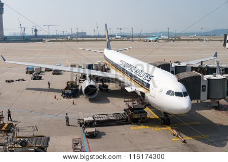 Singapore Airlines Plane On Airport Tarmac