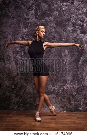 Graceful Slender Ballerina Dancing In Studio