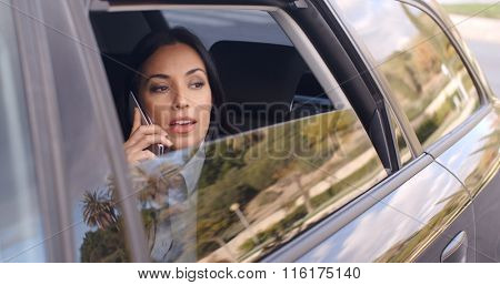 Curious business woman on phone looking from car