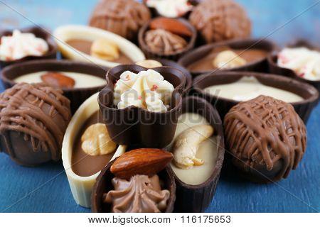 Chocolate sweets closeup, top view