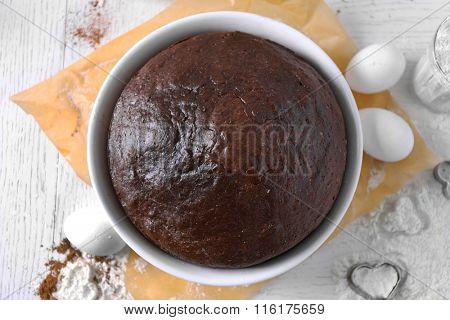 Cooked chocolate pie in a baking tray on a table, top view