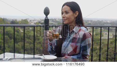 Young woman enjoying a hot cup of tea