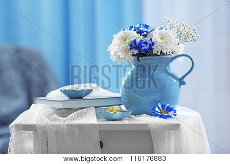 Blue home decor on bedside table in the room