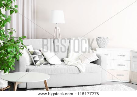 Room interior with sofa, commode and table