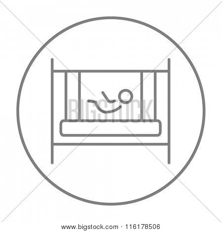 Baby laying in crib line icon.