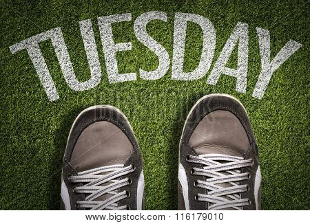 Top View of Sneakers on the grass with the text: Tuesday