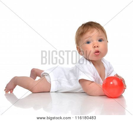 Infant Child Baby Boy Toddler Playing With Red Ball Toy In Hands On A Floor