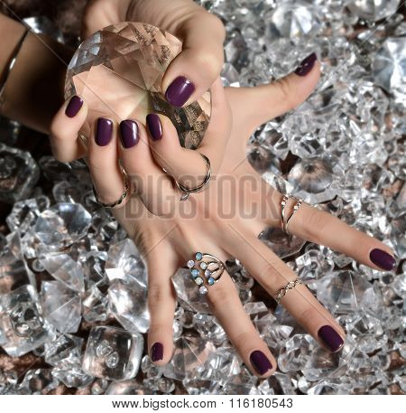 Purple Pattern Polish Nails And Silver Stacking Rings And Bracelets On A Ice Diamonds