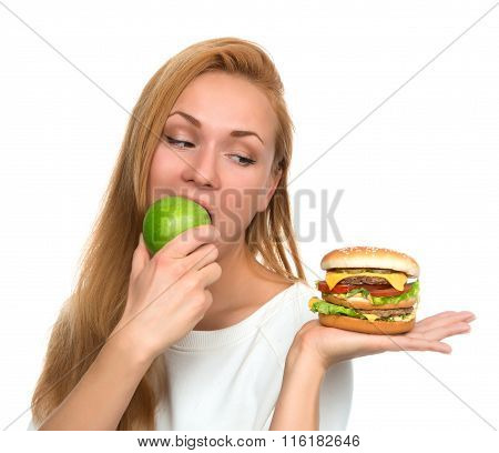 Woman With Burger Sandwich In Hand And Green Apple