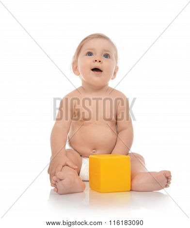 Infant Child Baby Boy Toddler Playing Holding Yellow Brick Toy In Hands