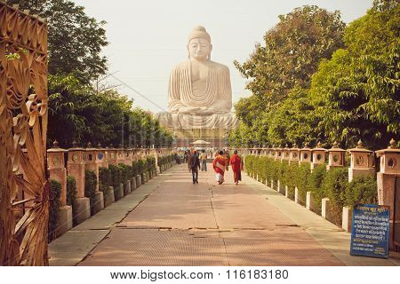 Monks And Other People Rushing To 24.38 Metre Buddha Statue