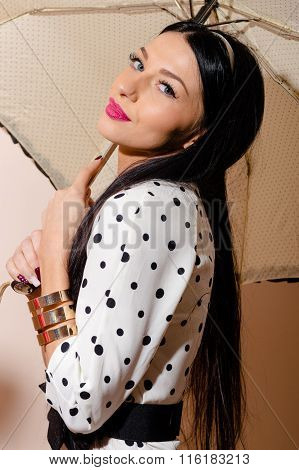 Young happy pinup style woman with umbrella