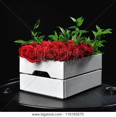Modern Rustic Bouquet Of Red Roses In Wood Box And Green Leafs On Black