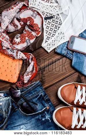 Jeans And Accessories On Wooden Boards