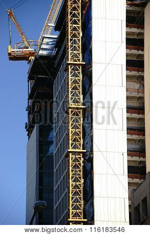 Crane on skyscraper