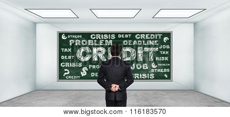 Businessman Looking On Drawing Credit Concept