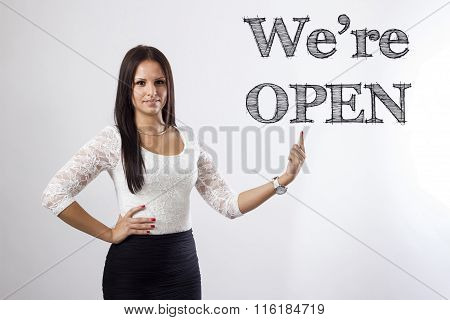 We're Open - Beautiful Businesswoman Pointing