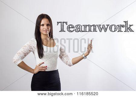 Teamwork - Beautiful Businesswoman Pointing