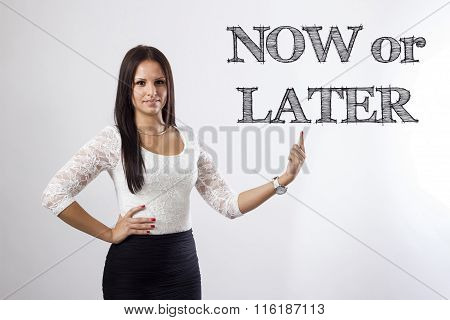 Now Or Later - Beautiful Businesswoman Pointing