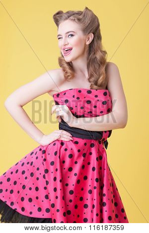 Cheerful young woman is expressing positive emotions