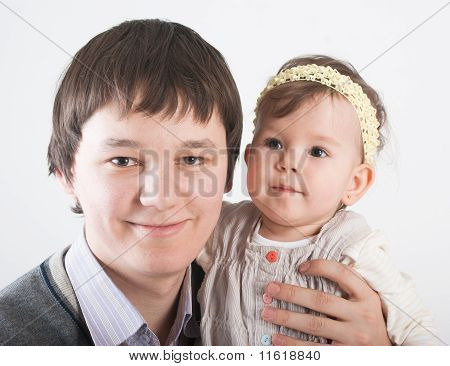Portrait Beautiful And Happy Fathers With A Daughter