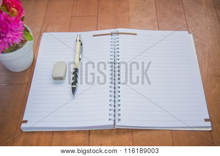 Blank Space Of Notepad With Supplies And Flower. Top View With Copy Space