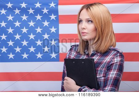 Attractive slim woman is expressing her patriotism