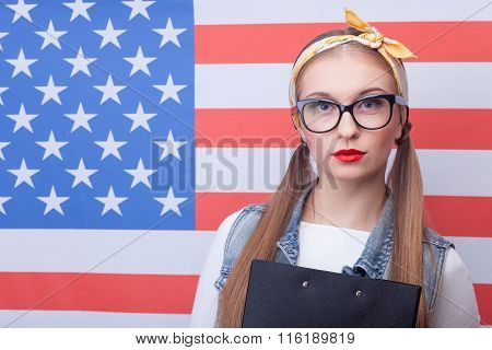 Cheerful American female student with folder of documents