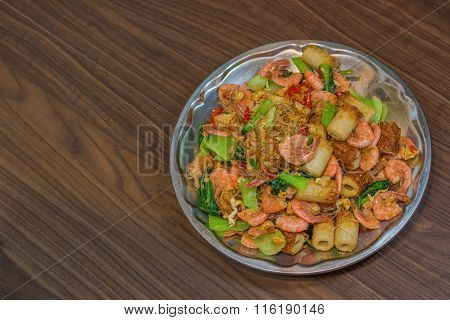 Shrimp Fried Vermicelli And Vegetables Close-up On The Table/ Top View Of A Horizontal.