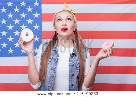 Cute healthy woman with unhealthy sweet pastry