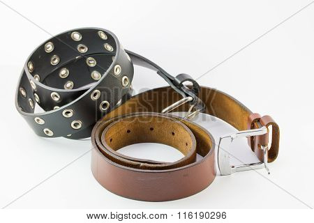 Old Two Leather Belt Roll On White Background.