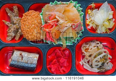 Japan Food Set Of Grilled Fish And Other In A Box Isolated On White / Japan Food (bento).