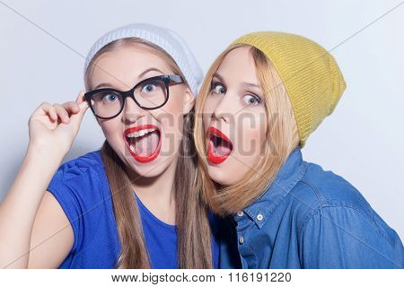 Pretty two girls are expressing positive emotions