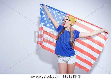 Cheerful young woman is expressing her patriotism