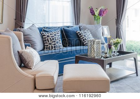 Classic Blue Sofa With Pillows And Wooden Table On Carpet In Living Room