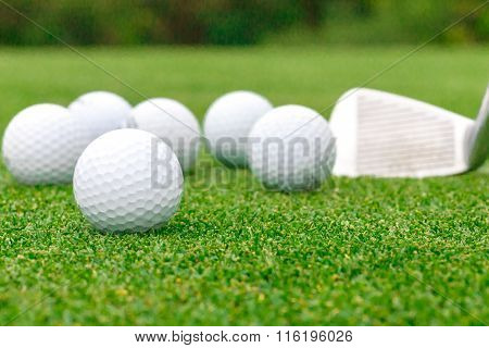 Golf Ball On Tee In Front Of Driver Green Course