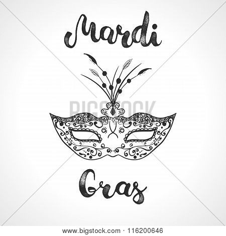 Mardi Gras mask and hand lettering calligraphic text Mardi Gras. Black and white carnival mask for a masquerade. Party mask for carnival in New Orlean Shrove Tuesday Fat Tuesday.