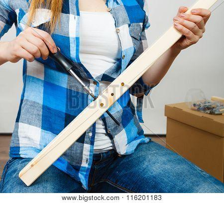 Human Hands Assembling Wooden Furniture. Diy.