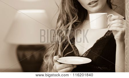 Sensual Woman Drinking Hot Coffee Beverage At Home