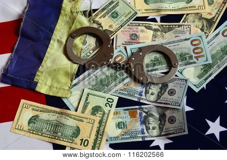 Partnership. USA and Ukraine Flag with handcuffs and money