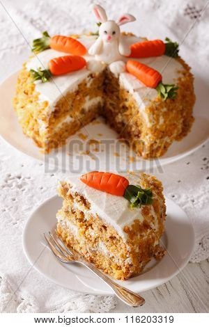 Beautiful Cake Decorated With Bunny And Carrot And Slice Close-up. Vertical