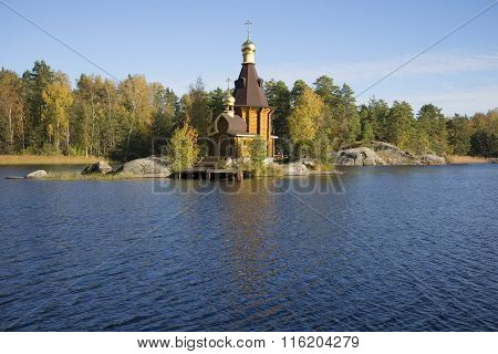 View of the wooden church of St. Andrew on the River Vuoksi sunny october day