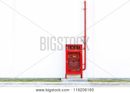Fire Extinguisher Equipment On The White Wall