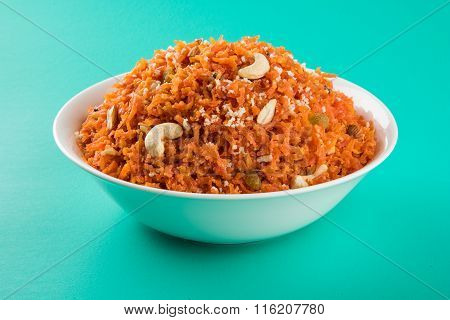 tasty gajar halwa or gajar ka halwa made up or fresh carrot, sugar and milk. decorated with almond o