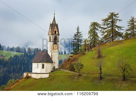 Romantic church in fog in La Valle - Wengen