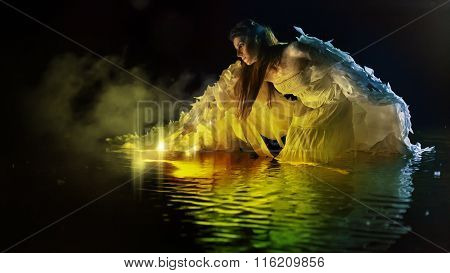 Beautiful White Angel Is Standing In The Magic Water.