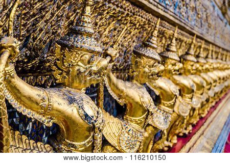 Golden garuda pattern standing at wat pha kaew
