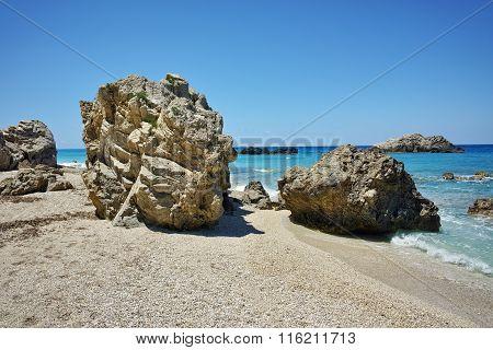 Stones over the sand of Megali Petra, Lefkada, Greece