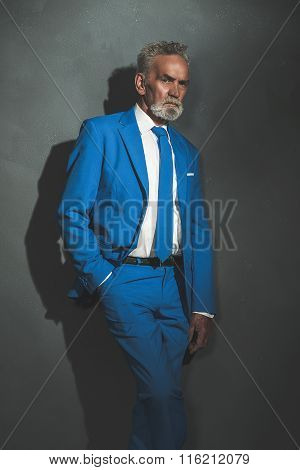 Middle Aged Businessman Leaning Against The Wall