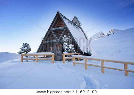 Typical wooden chalet in the Dolomites mountain
